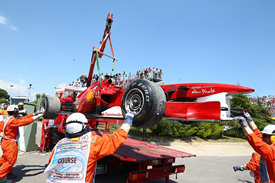 Felipe Massa's retired Ferrari is retrieved at Catalunya