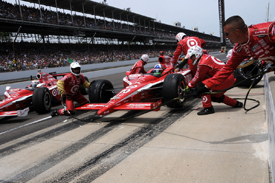 Dario Franchitti and Scott Dixon pit at Indianapolis
