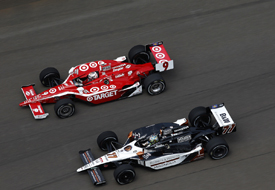 Alex Tagliani races with Scott Dixon at Indianapolis