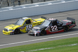Kyle Busch races with Joey Coulter in the Kansas Truck race