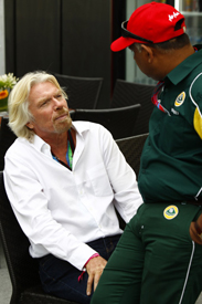 Richard Branson chats with Tony Fernandes in Montreal