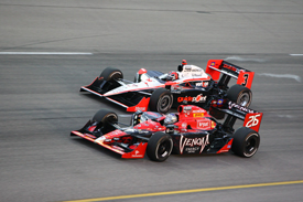 Marco Andretti races with Helio Castroneves at Iowa