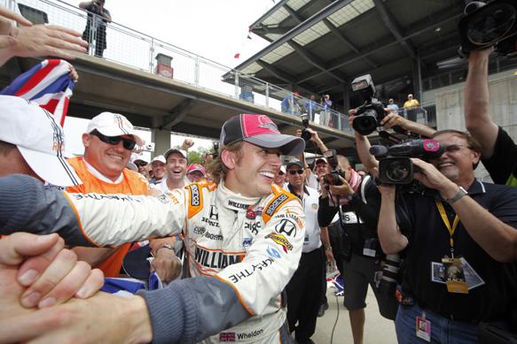 Dan Wheldon celebrates Indy 500 victory