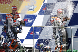 Andrea Dovizioso and Casey Stoner on the Mugello podium