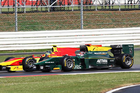 Jules Bianchi races with Christian Vietoris at Silverstone