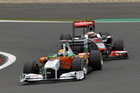 Adrian Sutil leads Jenson Button in Germany
