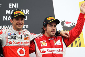 Fernando Alonso and Jenson Button on the Hungarian GP podium