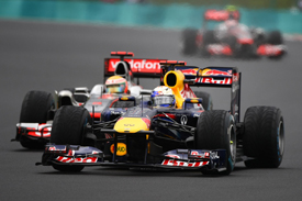 Sebastian Vettel fends off Lewis Hamilton in Hungary