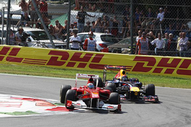 Fernando Alonso races with Sebastian Vettel at Monza
