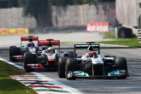 While Schumacher and Hamilton battled Button was waited for his moment