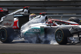 Schumacher and Hamilton continued to battle for position