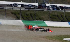 Helio Castroneves goes through the gravel at Motegi