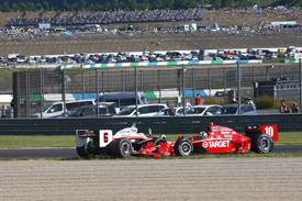 Dario Franchitti collides with Ryan Briscoe at Motegi
