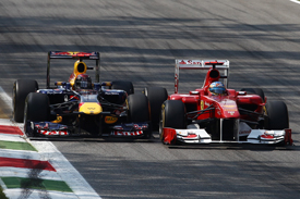 Sebastian Vettel races with Fernando Alonso at Monza