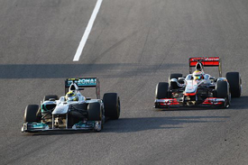 Nico Rosberg, Mercedes, races with Lewis Hamilton, McLaren, at Suzuka, 2011