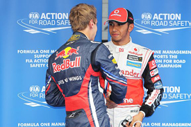 Sebastian Vettel congratulates Lewis Hamilton on Korea pole