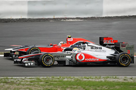 Lewis Hamilton, McLaren and Jerome D'Ambrosio, Virgin, Nurburgring 2011