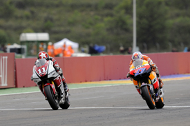 Casey Stoner beats Ben Spies over the line