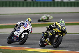 Cal Crutchlow leads Karel Abraham at Valencia