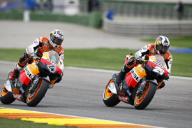 Andrea Dovizioso races Dani Pedrosa at Valencia