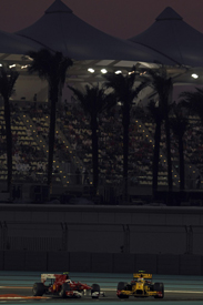 Vitaly Petrov leads Fernando Alonso in Abu Dhabi in 2010