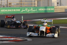 Paul di Resta, Force India, leads Sebastien Buemi, Toro Rosso, in Abu Dhabi