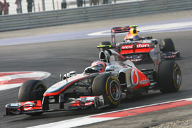 Jenson Button, McLaren, leads Mark Webber, Red Bull, 2011 Indian Grand Prix