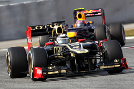 Kimi Raikkonen, Lotus, leads Mark Webber, Red Bull, Catalunya testing 2012