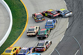 Clint Bowyer crashes into the Hendrick duo