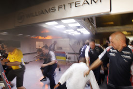 Just as the Williams team were celebrating a fire broke out in the garage engulfing the cars of Senna and Maldonado