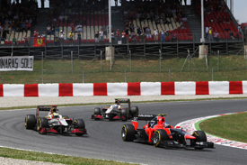 Charles Pic's Marussia leads Pedro de la Rosa and Narain Karthikeyan's HRTs in Spain 