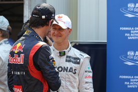 Michael Schumacher and Mark Webber