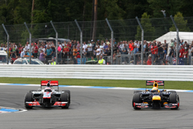 Jenson Button races with Sebastian Vettel at Hockenheim