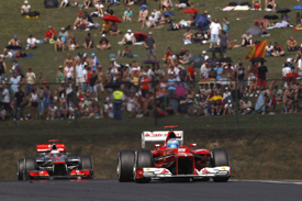 Fernando Alonso leads Jenson Button in Hungary