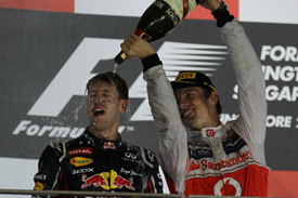Sebastian Vettel and Jenson Button on the Singapore podium
