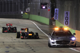 Sebastian Vettel leads Jenson Button in Singapore