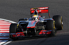 McLaren pleased with damage limitation