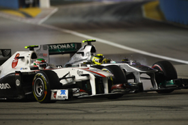 Sergio Perez races Nico Rosberg in Singapore