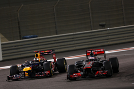 Sebastian Vettel passes Jenson Button in Abu Dhabi
