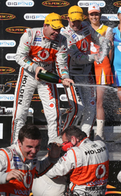 Craig Lowndes and Jamie Whincup on the Winton podium
