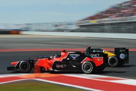 Timo Glock races Heikki Kovalainen at Austin
