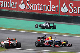 Vettel is champion, Button wins thriller