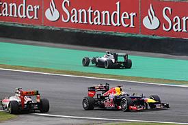 Vettel is champion, Button wins thriller