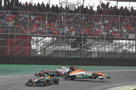 Nico Hulkenburg collides with Lewis Hamilton at Interlagos