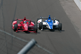 Dario Franchitti battles with Takuma Sato at Indianapolis
