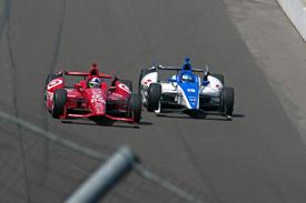Dario Franchitti battles with Takuma Sato at Indianapolis