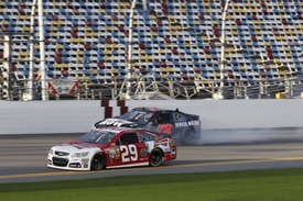 Kevin Harvick, Richard Childress Ford, passes the crashing Kurt Busch, Furniture Row Chevrolet