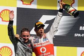 Jenson Button and Paddy Lowe on the Spa podium, 2011
