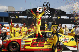 Joey Logano wins Michigan NASCAR Sprint Cup race 2013