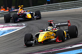 Magnussen on brink of title after win